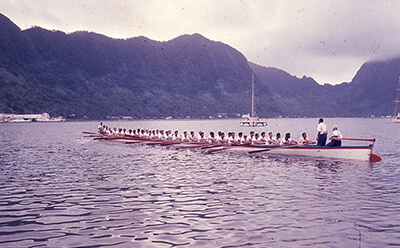 Fautasi being rowed through a bay